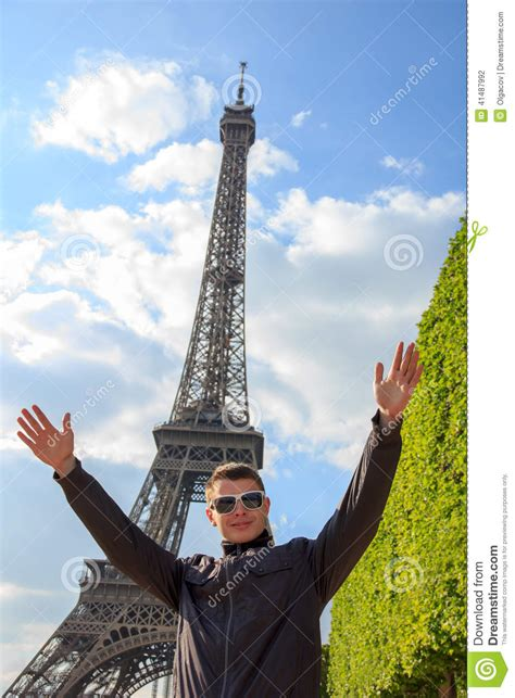 Young Man Hipster Shows The Eiffel Tower, France Stock